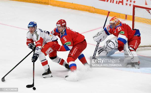 Russia's Dmitriy Yudin vies with Czech Republic's Lukas Rousek during the Channel One Cup of the Euro Hockey Tour ice hockey match between Russia and...