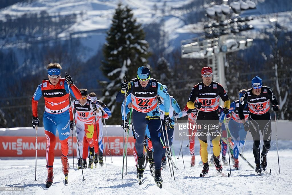 Russia's Dmitry Japarov (front L) and Germany's Axel Teichmann (front 2nd R) compete during 6 x 1,8 km Men's Classic Team Sprint of FIS Cross Country skiing World Cup at Laura Cross Country and Biathlon Center in Russian Black Sea resort of Sochi on February 3, 2013. Russia's Maxim Vylegzhanin and Dmitry Japarov took the first place ahead of Sweden's Teodor Peterson and Emil Joensson and Germany's Axel Teichmann and Tobias Angerer .