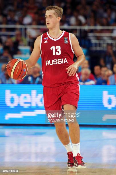 Russia's Dmitry Khvostov dribbles during the group A qualification basketball match between Israel and Russia at the EuroBasket 2015 in Montpellier...