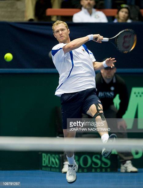Russia's Dmitry Tursunov returns against Sweden's Simon Aspelin and Robert Lindstedt during their Davis Cup first round doubles match in...