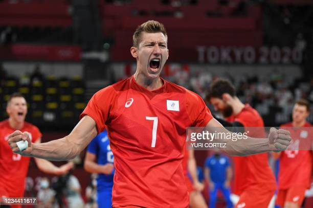 Russia's Dmitry Volkov celebrates as his team wins the men's quarter-final volleyball match between Canada and Russia during the Tokyo 2020 Olympic...
