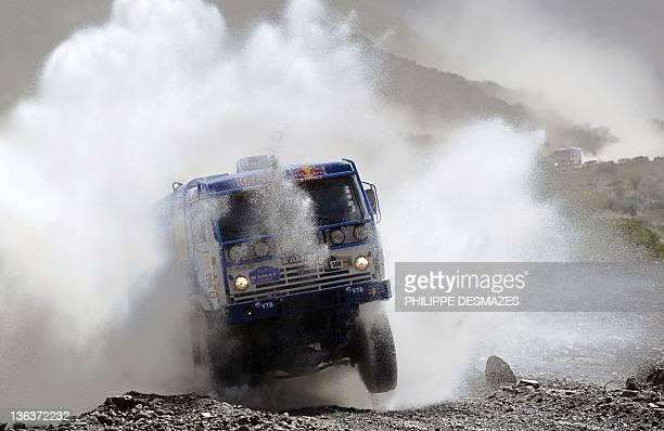 Russia's driver Andrey Karginov steers his truck Kamaz during the Stage 3 of the 2012 Dakar between San Rafael Mendoza province and San Juan San Juan...