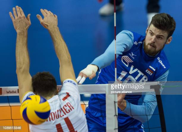 Russia's Egor Kliuka in action against France's Antonin Rouzier during the Olympic Qualification men's volleyball match between France and Russia in...