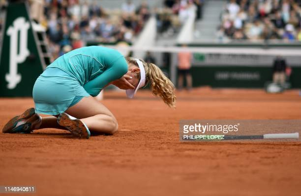Russia's Ekaterina Alexandrova celebrates after winning against Australia's Samantha Stosur during their women's singles second round match on day...