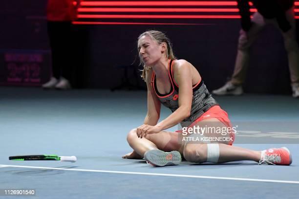 Russia's Ekaterina Alexandrova reacts during the semifinal tennis match against Belgium's Alison Van Uytvanck at the WTA Hungarian Open Ladies'...