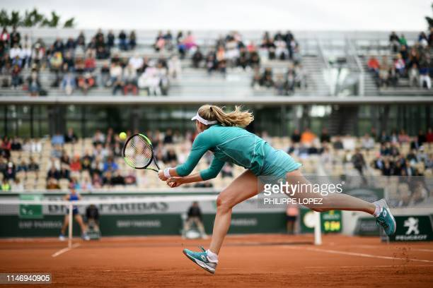 Russia's Ekaterina Alexandrova returns the ball to Australia's Samantha Stosur during their women's singles second round match on day five of The...