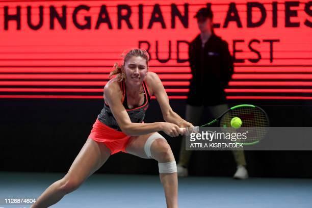 Russia's Ekaterina Alexandrova returns the ball to Belgium's Alison Van Uytvanck during their semifinal match of the WTA Hungarian Open Ladies'...