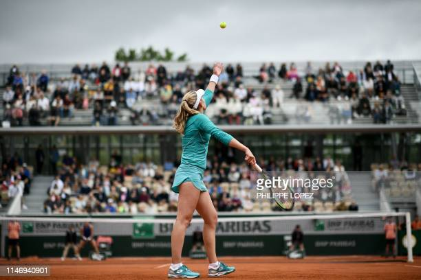 Russia's Ekaterina Alexandrova serves the ball to Australia's Samantha Stosur during their women's singles second round match on day five of The...