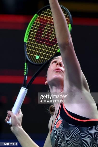 Russia's Ekaterina Alexandrova serves the ball to Belgium's Alison Van Uytvanck during their semifinal match of the WTA Hungarian Open Ladies' tennis...