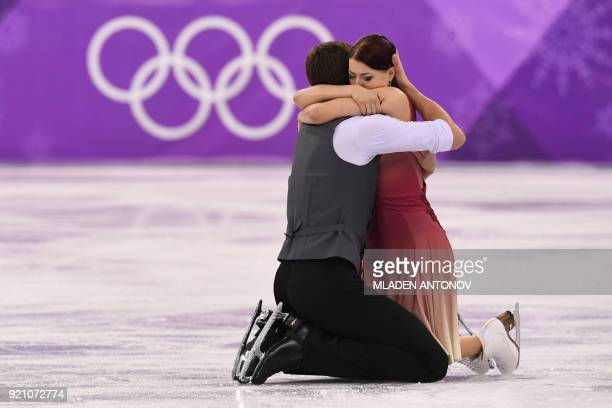 Russia's Ekaterina Bobrova and Russia's Dmitri Soloviev hug after competing in the ice dance free dance of the figure skating event during the...