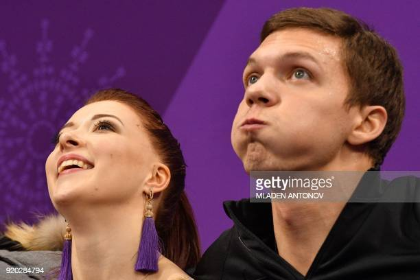 Russia's Ekaterina Bobrova and Russia's Dmitri Soloviev react after competing in the ice dance short dance of the figure skating event during the...