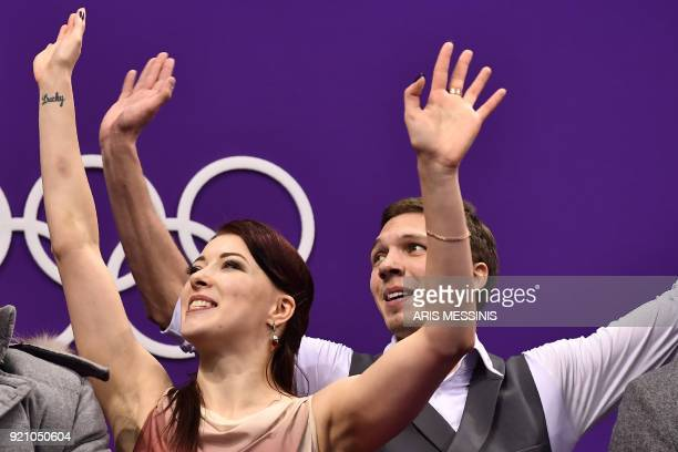 Russia's Ekaterina Bobrova and Russia's Dmitri Soloviev react after competing in the ice dance free dance of the figure skating event during the...