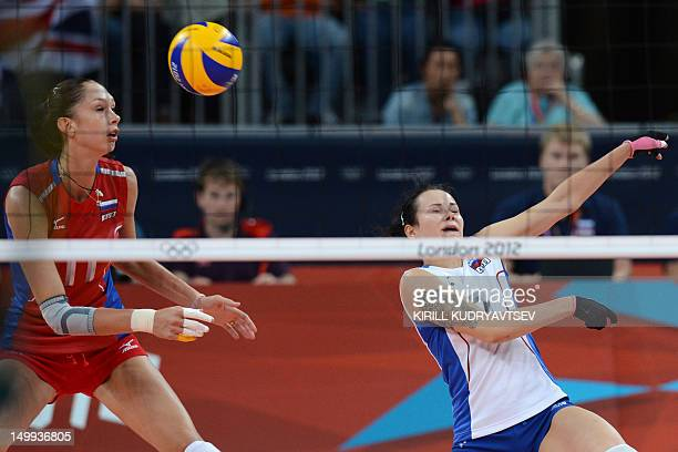 Russia's Ekaterina Gamova and Svetlana Kryuchkova attempt to set during the Women's quarterfinal volleyball match between Russia and Brazil in the...