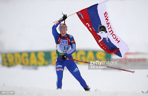 Russia's Ekaterina Iourieva celebrates her team's victory as she crosses the finish line in the women's 4 x 6 km relay during the biathlon World Cup...