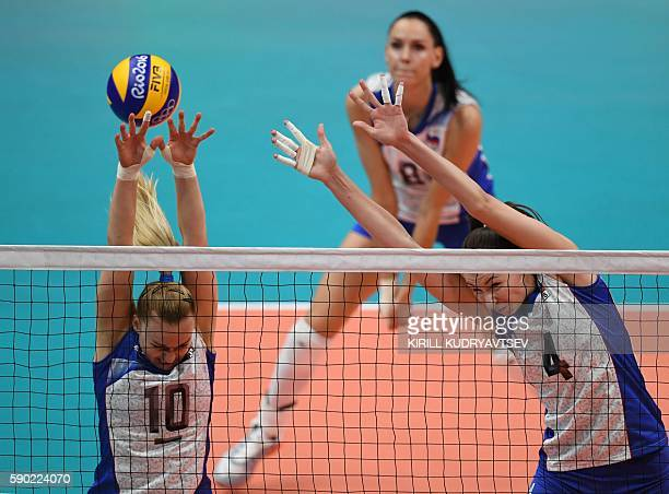 Russia's Ekaterina Kosianenko and Russia's Irina Zarayazhko attempt to block the ball during the women's quarterfinal volleyball match between Russia...