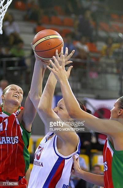 Russia's Ekaterina Lisina vies with Belarus's Yelena Leuchanka and Anastasiya Veremeenko during their Group F qualifying round of the Women's...
