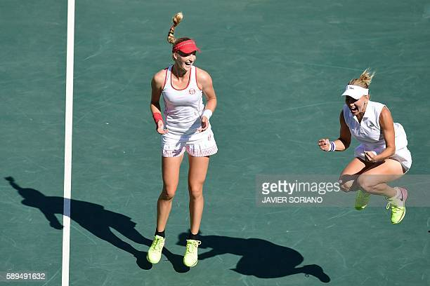 TOPSHOT Russia's Ekaterina Makarova and teammate Russia's Elena Vesnina celebrate after winning their women's doubles finals tennis match against...