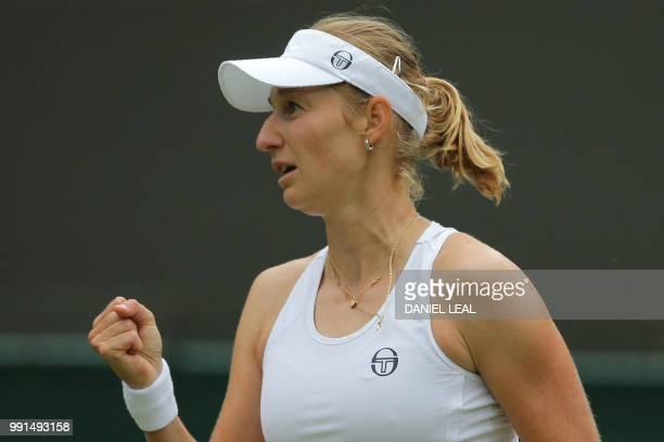 Russia's Ekaterina Makarova celebrates a point against Denmark's Caroline Wozniacki during their women's singles second round match on the third day...