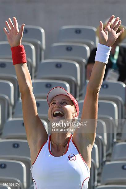 Russia's Ekaterina Makarova celebrates after winning the women's doubles finals tennis match with teammate Russia's Elena Vesnina against...