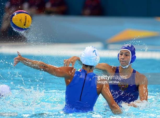 Russia's Ekaterina Prokofyeva is challenged by Italia's Tania di Mario during the women's water polo preliminary round groupe B match between Italy...