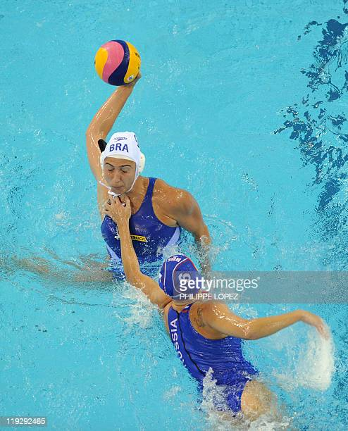 Russia's Ekaterina Tankeeva and Brazil's Gabriela Leme Gozani compete in their group C women's water polo preliminary round match in the FINA World...