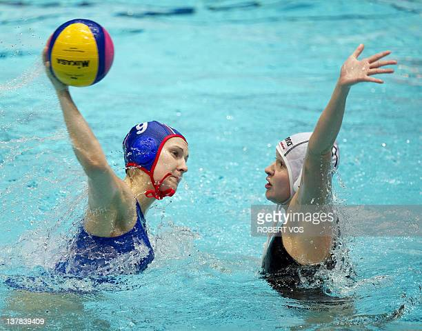 Russia's Ekaterina Tankeeva fights for the ball with Hungary's Kata Maria Menczinger during their European Championships Water Polo match for third...
