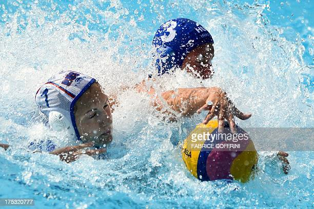 Russia's Ekaterina Tankeeva vies with Hungary's Dora Antal during their women's water polo bronze medal match at the FINA World Championships on...
