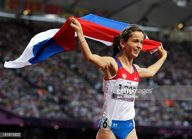 Russia's Elena Ivanova celebrates winning gold in the women's 100m T36 final during the athletics competition at the London 2012 Paralympic Games at...