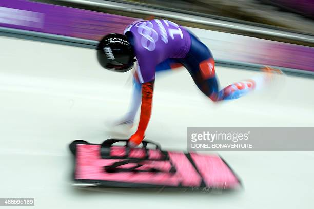 Russia's Elena Nikitina takes part in a Women's Skeleton official training during the Sochi Winter Olympics on February 11 2014 at the Sanki Sliding...