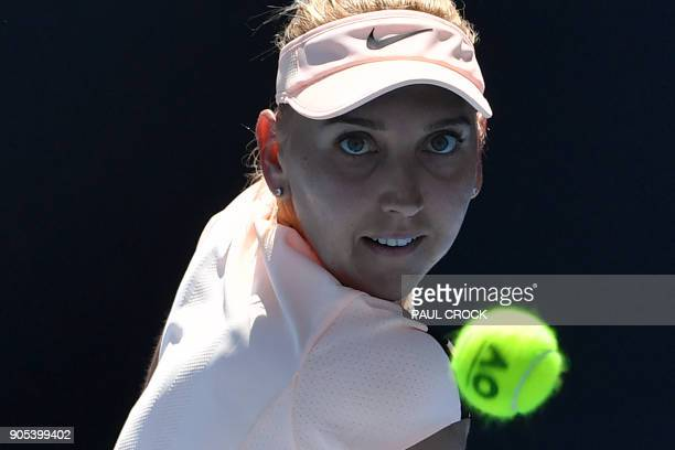 Russia's Elena Vesnina hits a return against Tunisia's Ons Jabeur during their women's singles first round match on day two of the Australian Open...