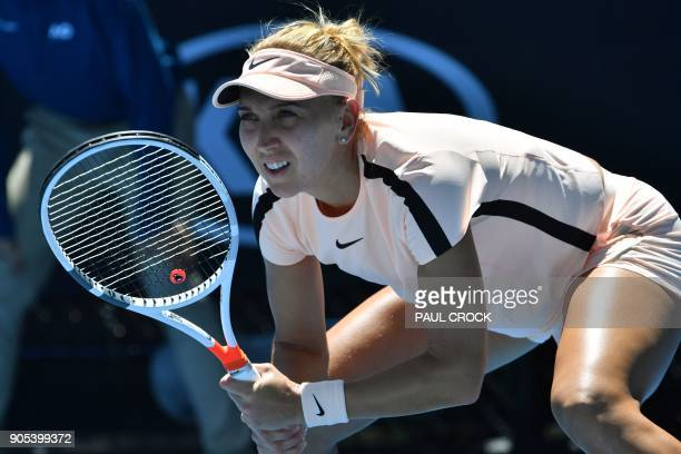 Russia's Elena Vesnina prepares to return serve against Tunisia's Ons Jabeur during their women's singles first round match on day two of the...