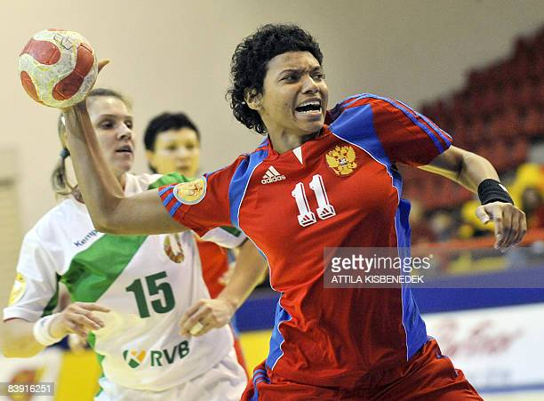 Russia's Emiliya Turey scores in front of Belarus' Iryna Dronova during their 8th Women's Handball European Championships match on December 4 2008 at...