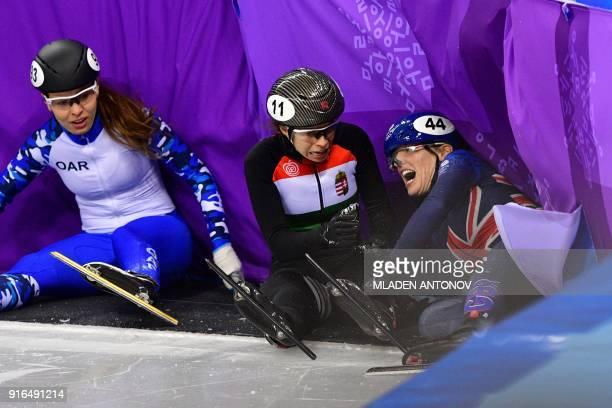Russia's Emina Malagich , Hungary's Petra Jaszapati and Britain's Charlotte Gilmartin crash in the women's 500m short track speed skating heat event...
