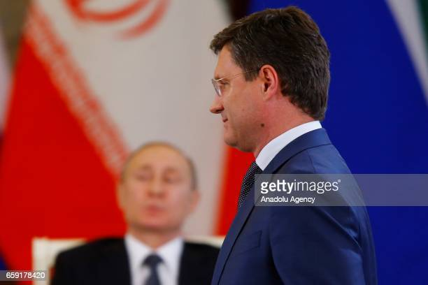 Russia's Energy Minister Alexander Novak is seen during a meeting with Russian President Vladimir Putin and Iranian President Hassan Rouhani in...