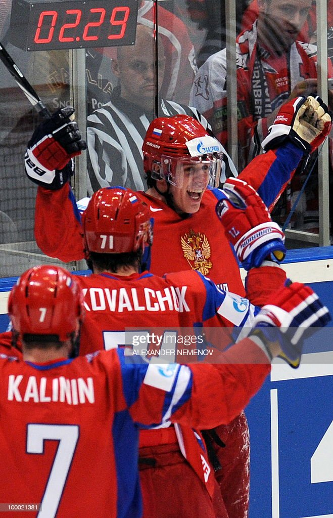 Russia's Evgeni Malkin (R) of NHL's Pittsburgh Penguins celebrates scoring with his teammates during the IIHF Ice Hockey World Championship quarter-final match Switzerland vs Germany in the southern German city of Mannheim on May 20, 2010. The 2010 IIHF Ice Hockey World Championships are taking place in Germany from May 7 to 23, 2010.