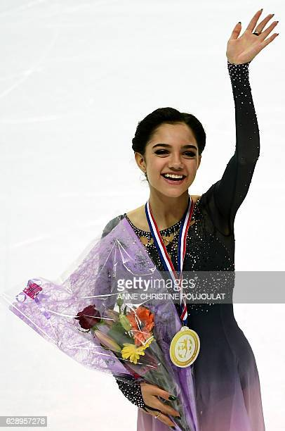 Russia's Evgenia Medvedeva celebrates on the podium after winning the Senior Ladies Free program at the ISU Grand Prix of figure skating Final on...