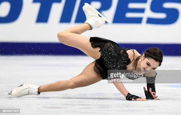 Russia's Evgenia Medvedeva falls down as she competes during the senior Ladies free skating at the ISU Grand Prix Rostelecom Cup in Moscow on October...