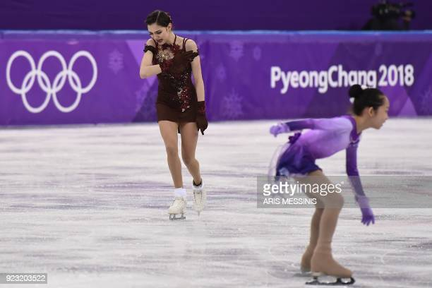 Russia's Evgenia Medvedeva reacts after competing in the women's single skating free skating of the figure skating event during the Pyeongchang 2018...