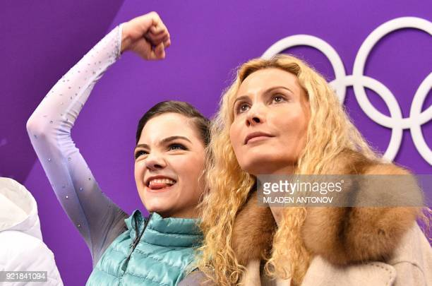 TOPSHOT Russia's Evgenia Medvedeva reacts after her performance in the women's single skating short program of the figure skating event during the...