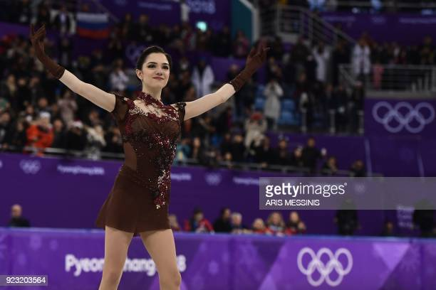 TOPSHOT Russia's Evgenia Medvedeva reacts during the venue ceremony in the women's single skating free skating of the figure skating event during the...