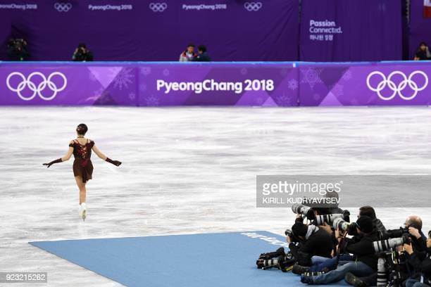 Russia's Evgenia Medvedeva waves after the women's single skating free skating of the figure skating event during the Pyeongchang 2018 Winter Olympic...