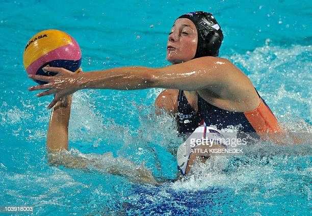 Russia's Evgenia Soboleva fights for the ball with the Netherlands' Iefke van Belkum during their semifinal European Championship water polo match at...