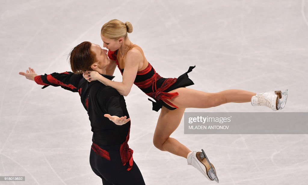 Russia's Evgenia Tarasova and Russia's Vladimir Morozov compete in the pair skating short program of the figure skating event during the Pyeongchang 2018 Winter Olympic Games at the Gangneung Ice Arena in Gangneung on February 14, 2018. / AFP PHOTO / Mladen ANTONOV