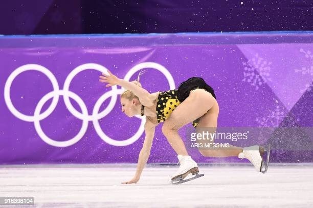 Russia's Evgenia Tarasova falls as she and Russia's Vladimir Morozov compete in the pair skating free skating of the figure skating event during the...
