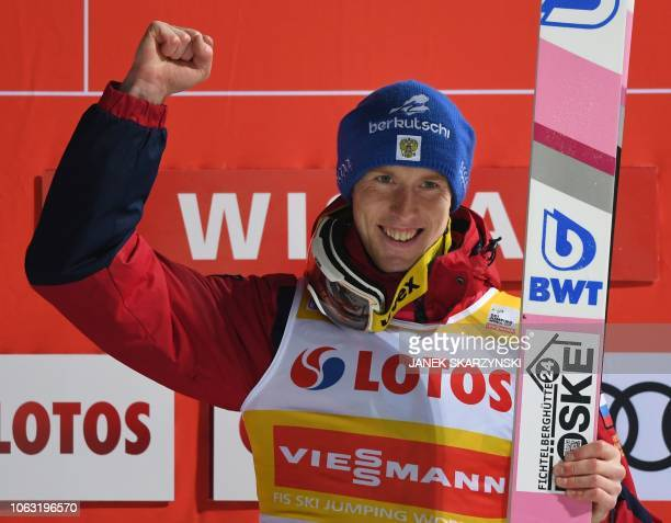Russia's Evgeniy Klimov celebrates on the podium after the the FIS Ski Jumping World Cup in Wisla Poland on November 18 2018 Russia's Evgeniy Klimov...