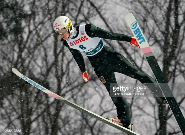 Russia's Evgeniy Klimov soars through the air during the the FIS Ski Jumping World Cup in Wisla Poland on November 18 2018 Russia's Evgeniy Klimov...