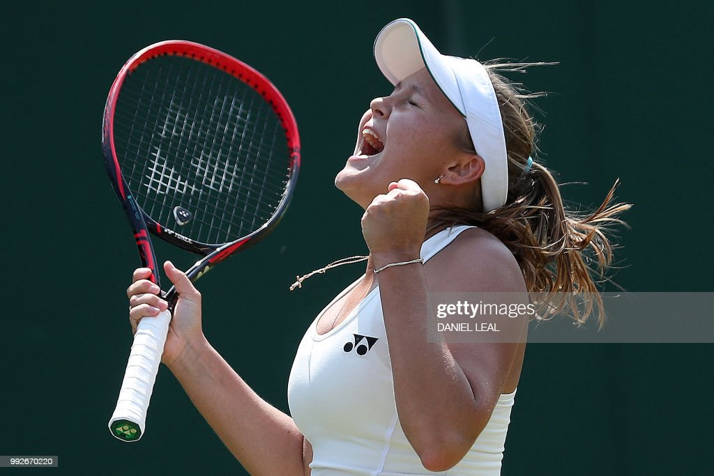TOPSHOT - Russia's Evgeniya Rodina celebrates after winning against US player Madison Keys during their women's singles third round match on the fifth day of the 2018 Wimbledon Championships at The All England Lawn Tennis Club in Wimbledon, southwest London, on July 6, 2018. - Rodina won the match 7-5, 5-7, 6-4. (Photo by Daniel LEAL-OLIVAS / AFP) / RESTRICTED