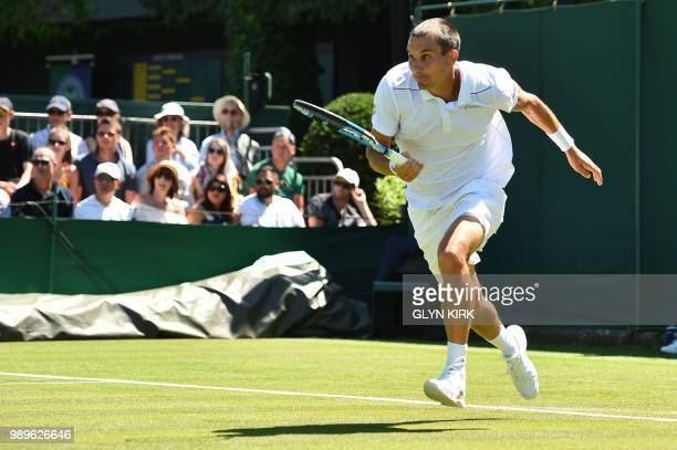 Russia's Evgeny Donskoy returns to Germany's Philipp Kohlschreiber during their men's singles first round match on the first day of the 2018...