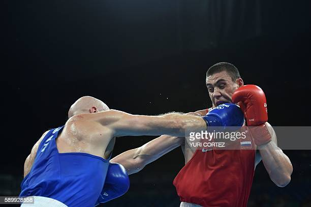 Russia's Evgeny Tishchenko fights Kazakhstan's Vassiliy Levit during the Men's Heavy Final Bout match at the Rio 2016 Olympic Games at the Riocentro...