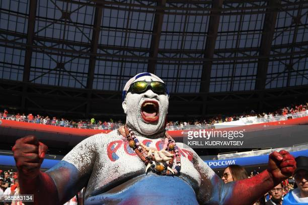 Russia's fan cheers his team during the Russia 2018 World Cup round of 16 football match between Spain and Russia at the Luzhniki Stadium in Moscow...